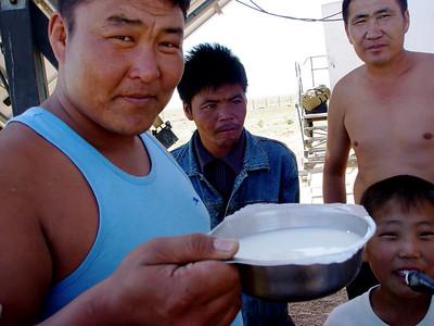 DSC03163Mongolian nomads offering mares milk